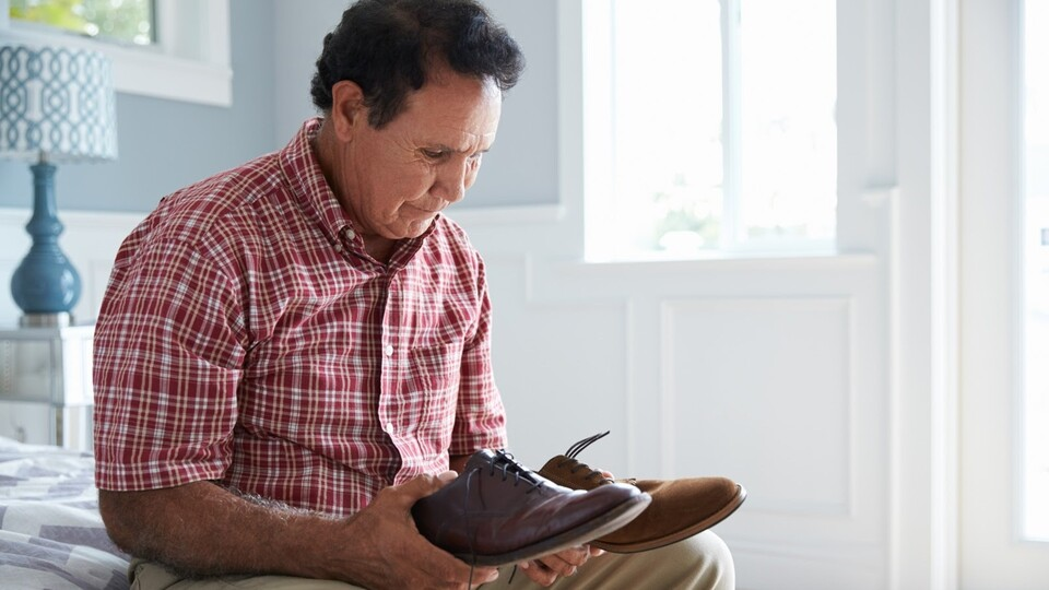 Man setting with shoes